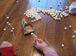 almost unschoolers building a bigger pyramid marshmallow and
