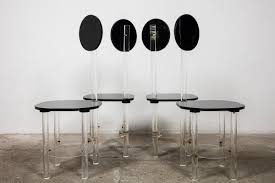 black and clear sculptural lucite high back dining room chairs price per set