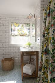 525 best bathrooms images on pinterest bathrooms bathroom ideas whimsical bathroom with yellow and green floral shower curtain cottage bathroom