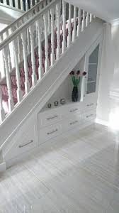 custom made under stairs storage unit for the foyer wood works