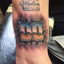 chrome letter tattoo by mike fabrizio at double deez tattoos in