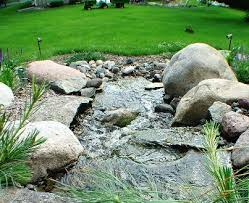 make a statement with your mn landscaping use boulders