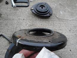 honda pilot struts how can i tell if my strut mount is bad i am replacing my