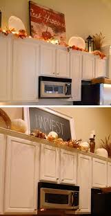 how to decorate the top of kitchen cupboards 20 stylish and budget friendly ways to decorate above