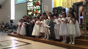 communicants sing a song of thanksgiving after receiving