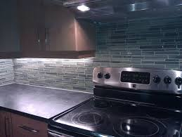 stainless steel appliance for kitchen with glass backsplash in