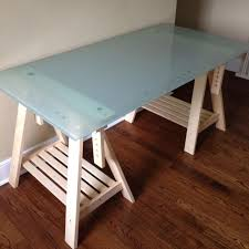 Ikea Sawhorse Desk Find More Ikea Glass Top Desk With Adjustable Saw Horse Legs Edit