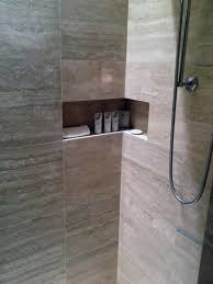 this cool shower niche wraps the corner at the st regis bal