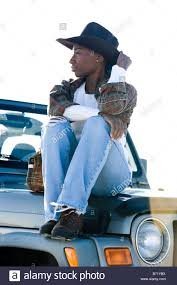 jeep hat young african american woman wearing cowboy hat sitting on jeep