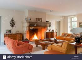 large open fireplace in living room with vico magistretti velvet
