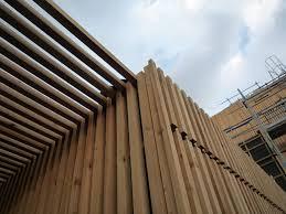 rivestimento listelli legno residenze per studenti lan architecture arketipo