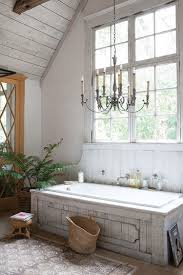 chic farmhouse bathroom ideas with classic chandelier lighting