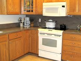 Does Corian Stain Countertops Kitchen With White Cabinets And Black Appliances