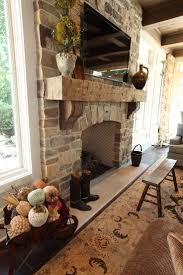 sophisticated casual home in cleveland oh by w design rustic fireplace with stone and heavy mantel