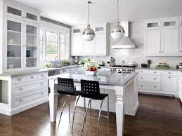 kitchens with white cabinets and wood floors cream tile top on the