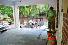 tiling cleaning and grouting an outdoor area house