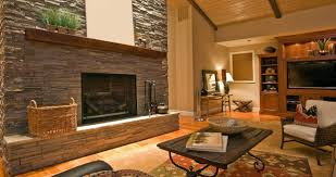 stone wall exposed and fireplace with enchanting wood cupboard and