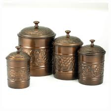 old dutch international 811 antique embossed canisters set of 4