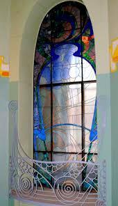 interior art nouveau window glass art with balcony fence