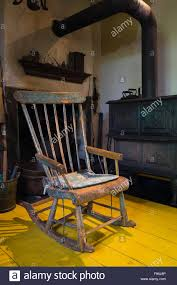antique rocking chair and wood stove in front of the fireplace in
