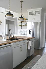 light grey kitchen cabinets with wood countertops a tour of our new kitchen from thrifty decor