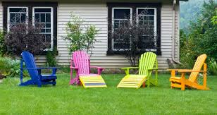 Multi Coloured Chairs by Multi Coloured Chairs On Front Yard Country Side Ontario Canada