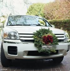 Christmas Vehicle Decorations Car Decorated With Christmas Wreath Closeup Stock Photo Getty Images