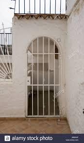 villa gate spain spanish tenerife canary white wall arch tile