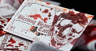 17 insane body piercing and tattoo parlor business card designs