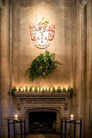 reception décor photos fireplace with wreath garland and