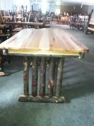 rustic hickory trestle dining table with solid top and bark on