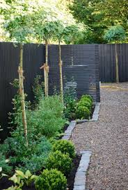 backyard garden with gravels and grey wooden fences selecting
