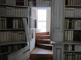 interior amazing secret bookcase door staircase in library with