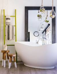 make your room feel bigger with these fabulous oversized mirror ideas