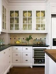 Glass Cabinet For Kitchen Love The Little Pops Of Green In With The Clean White Dishes For