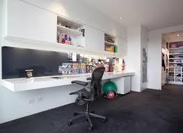 white home interior furniture white wooden desk and white swivel chair on white floor
