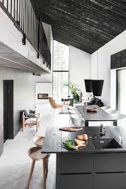 open floor plan narrow house living room dining room kitchen black