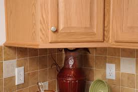 under cabinet moulding on kitchen o h cabinets commodore of