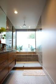 narrow bathroom ideas with walk in shower and window and wall