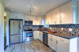 white kitchen cabinets brown countertops l shape kitchen room design with white cabinets brown granite