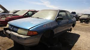 junkyard find 1991 ford escort pony