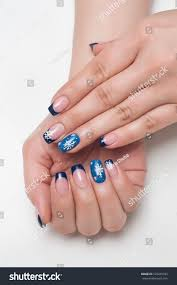 christmas blue french manicure white snowflakes stock photo