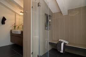 vertical tiles bathroom contemporary with wood ceiling a compliant