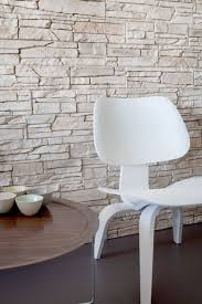 Modern Home Decor With Natural Color Furniture And by Natural Stone Wall Decor With White Acrylic Chair Also Round Wood