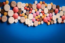 many colored tablets on blue background stock photo colourbox