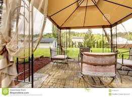 backyard gazebo with antique chairs stock photo image 41393215