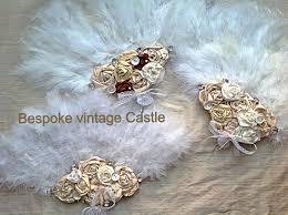feather fan bespoke vintage castle wedding accessories brides pearl bouquets