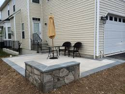 Concrete Backyard Ideas by Stamped Concrete Patio Coming Off Of A Simple Deck Just Needs