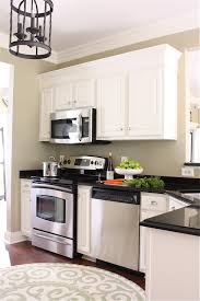 Adding Trim To Kitchen Cabinets by The Yellow Cape Cod Making Cabinets Taller Builder Cabinets Go