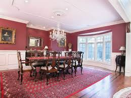 traditional dining room with crown molding u0026 carpet in